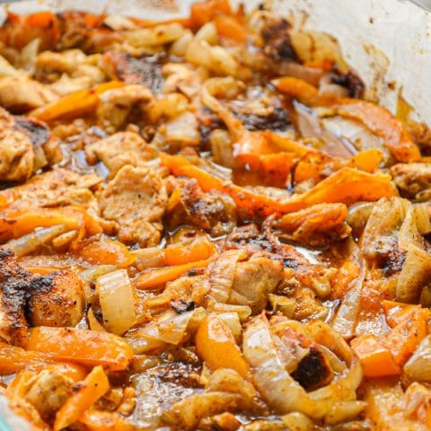 It really doesn't get any easier than these 9 X 13 Chicken Fajitas! Just add the ingredients, bake, and serve with tortillas, cheese, and sour cream and Taco Tuesday is a cinch!