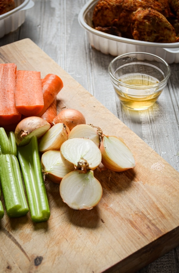Aromatic vegetables are the key to a successful instant pot bone broth. Carrots, celery, and onions are my favorite.