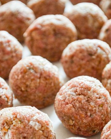 A tray full of freezer meatballs.