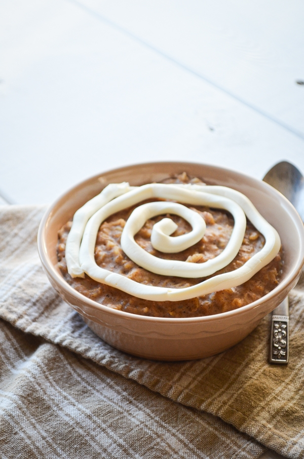 A comforting bowl of cinnamon roll oatmeal, complete with a cream cheese swirl.
