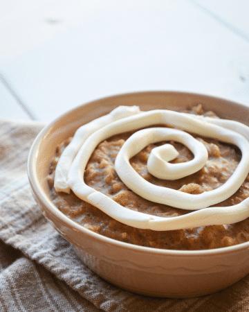 A bowl of cinnamon oatmeal with a cream cheese swirl.