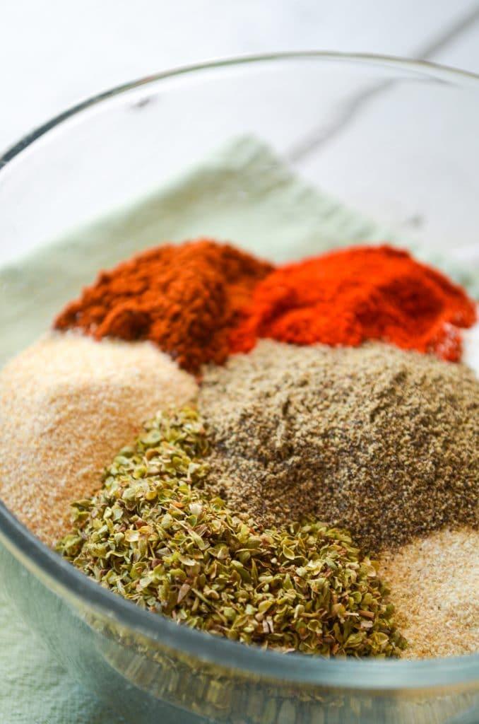 A bowl of various seasonings; ingredients for chicken taco seasoning.