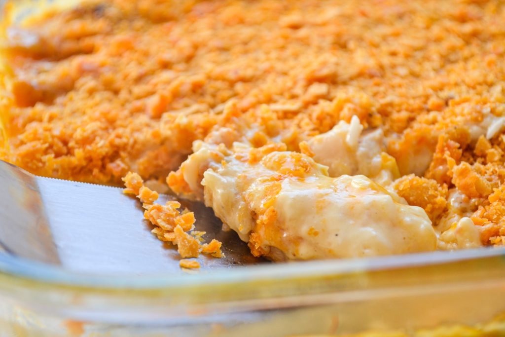 A close up of chicken divine casserole with a crushed cracker topping.