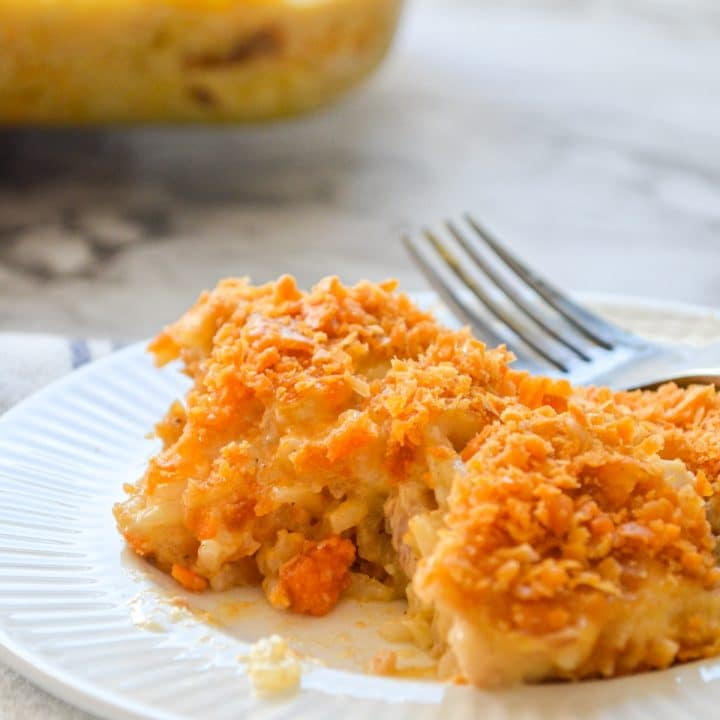 Chicken and rice casserole on a small white plate.