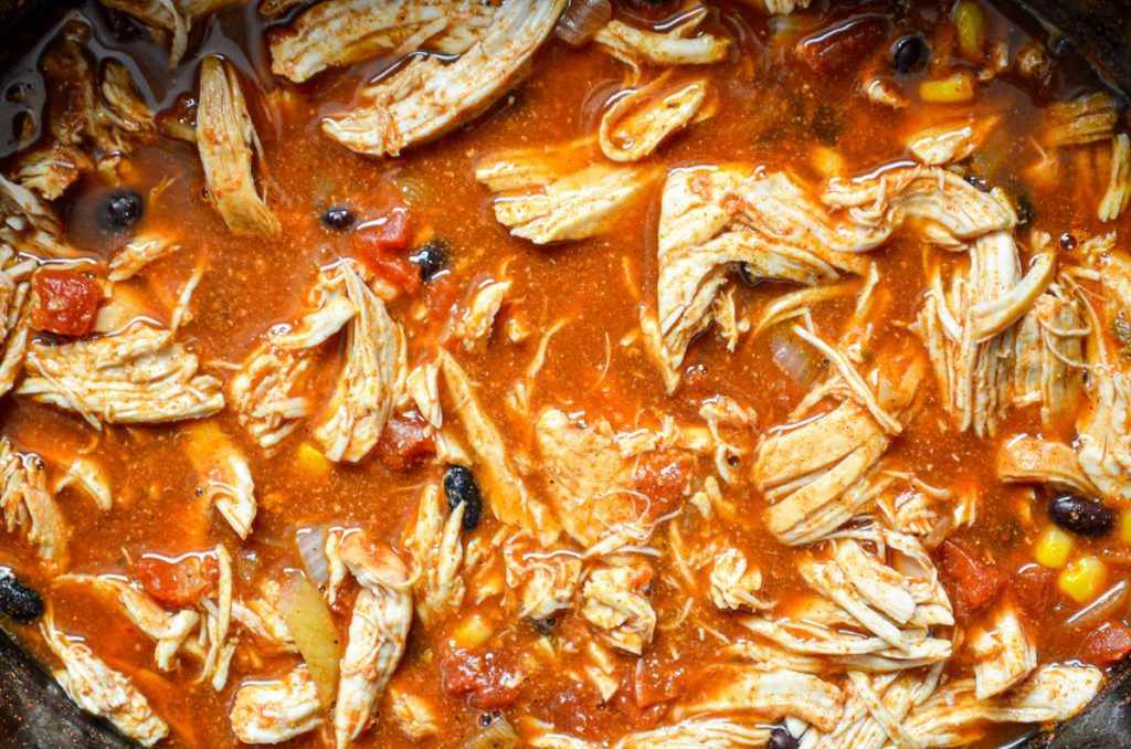 A close up of chicken taco soup made in the crockpot.