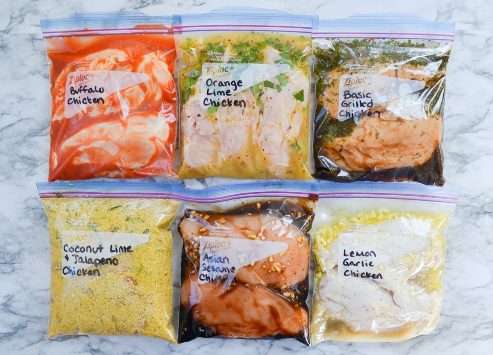 6 freezer bags, filled with freezer chicken marinades.