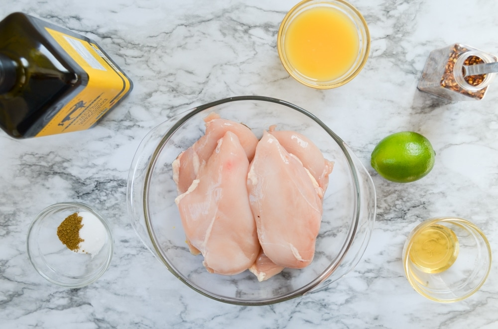 The ingredients to make orange lime chicken marinade.
