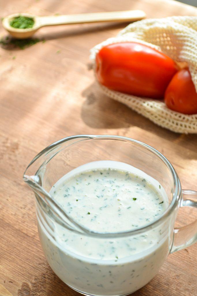 Homemade buttermilk ranch dressing in a small cruet.