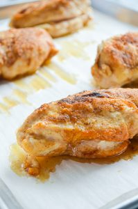Chicken breasts that have been fully cooked.