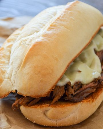 A french dip sandwich on butcher paper.
