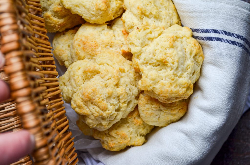 A basket full of sourdough drop biscuits.