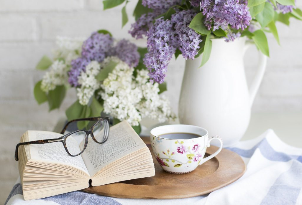 A warm cup of tea or coffee and a book.
