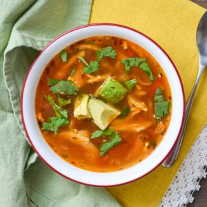 A bowl oMexican chicken soup