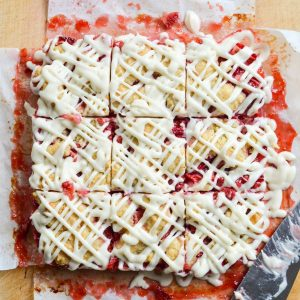Strawberry oatmeal crumb bars, cut into squares.