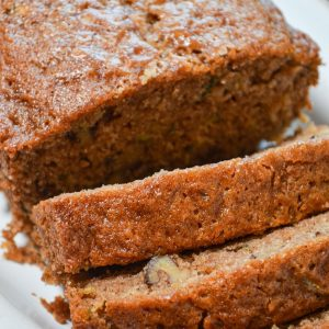 A loaf of sourdough zucchini bread, sliced into individual servings.