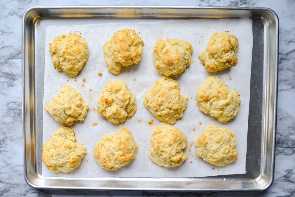 A baking sheet of sourdough discard drop biscuits.