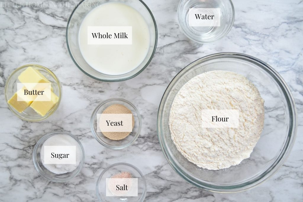 The ingredients needed to make snowflake rolls: flour, yeast, salt, sugar, water, milk, and butter.